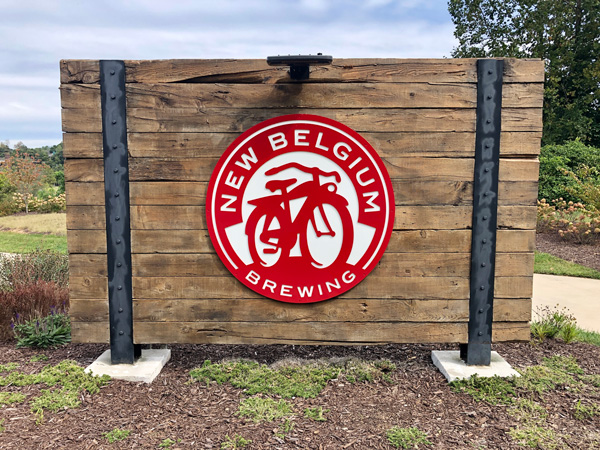 New Belgium Brewing Asheville NC with logo on wooden sign at entrance