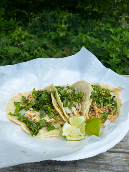 Taqueria Munoz Food Truck at Zillicoah Beer Company with three soft tacos on a plate garnished with lime and cilantro