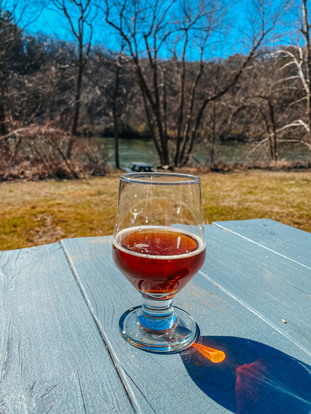 Zillicoah Beer Company Asheville NC with amber beer on picnic table outside