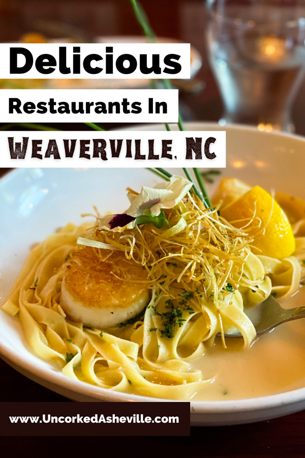 Best Restaurants In Weaverville NC with Scallops and pasta dish from Glass Onion Restaurant Weaverville NC with fettuccine, lemon and oil sauce, green garnish, and scallops