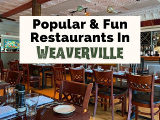 Best Weaverville Restaurants NC with picture of Glass Onion with tables, bar, blown glass hanging from the ceiling