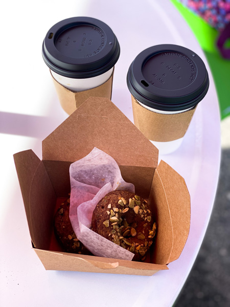 BimBeriBon Gluten Free Bakery Cafe West Asheville with vegan and gluten free donut and two cups of take away coffee