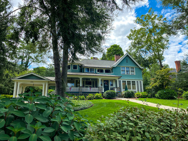 Black Walnut B&B Inn Historic Montford in Asheville NC greenish colored bed and breakfast with front porch and tree
