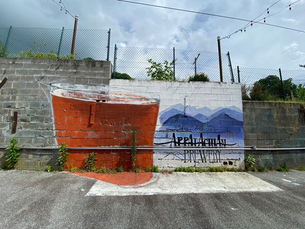 Southern Appalachian Brewery Hendersonville NC mural with Blue Ridge Mountains and amber colored craft beer mural