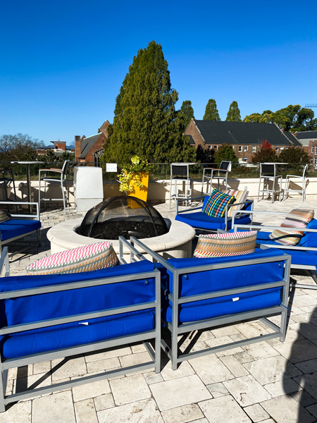 Aloft Downtown Asheville rooftop pool bar with blue couches and fire pit overlooking mountains