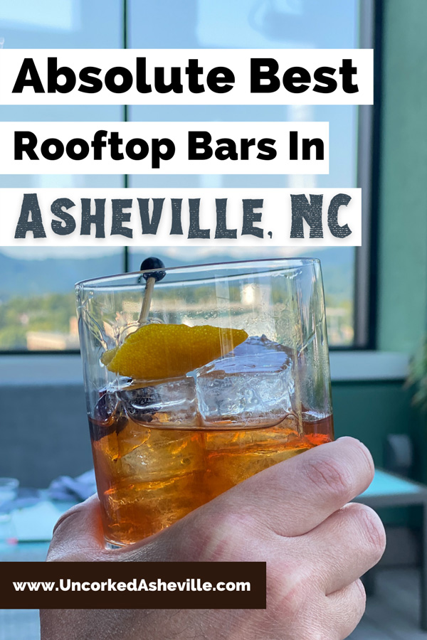 Best Asheville Rooftop Bars Restaurants Pinterest pin with Capella On 9 with white hand holding up an Old Fashioned Craft cocktail in front of window with view of Blue Ridge Mountains