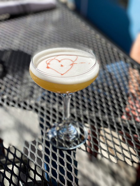 Isa's French Bistro Downtown Asheville Cocktail with heart on top in martini glass