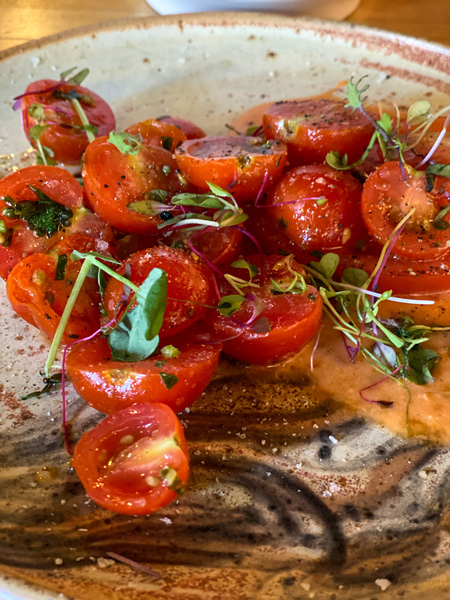 Jargon American Restaurant Asheville NC with appetizer of tomato basil salad