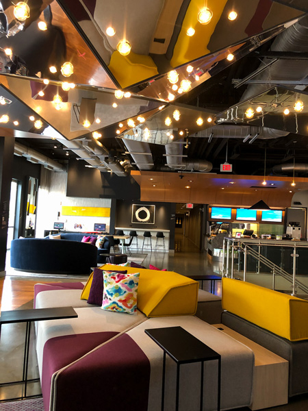W XYZ Bar in Aloft Downtown Asheville with yellow and purple colorful couches and selfie mirrors