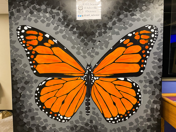 Asheville Museum of Science with orange and black monarch butterfly mural
